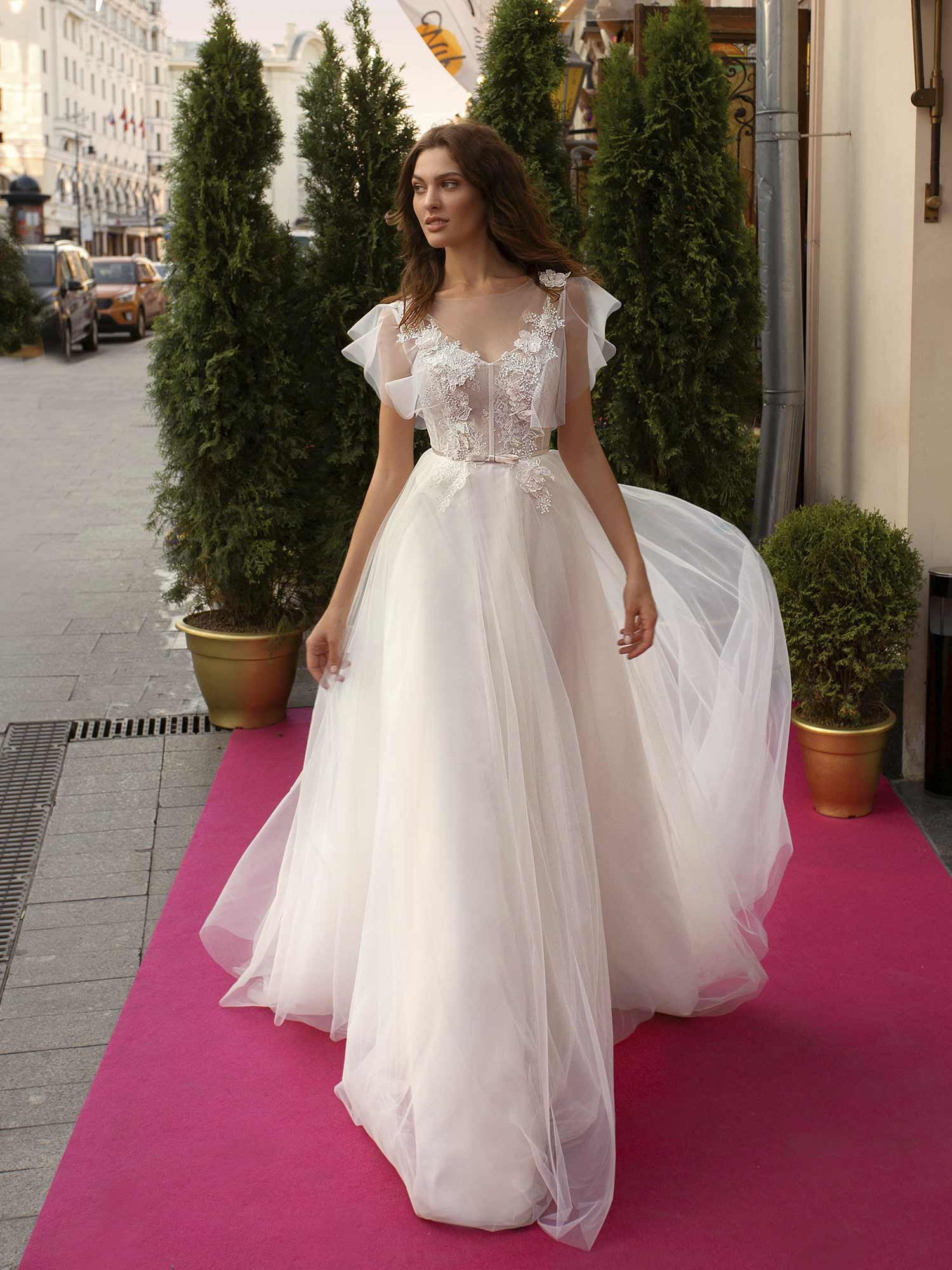 Cape Sleeved Wedding Dress With Illusion Neckline And Floral Applique Across The Bodice