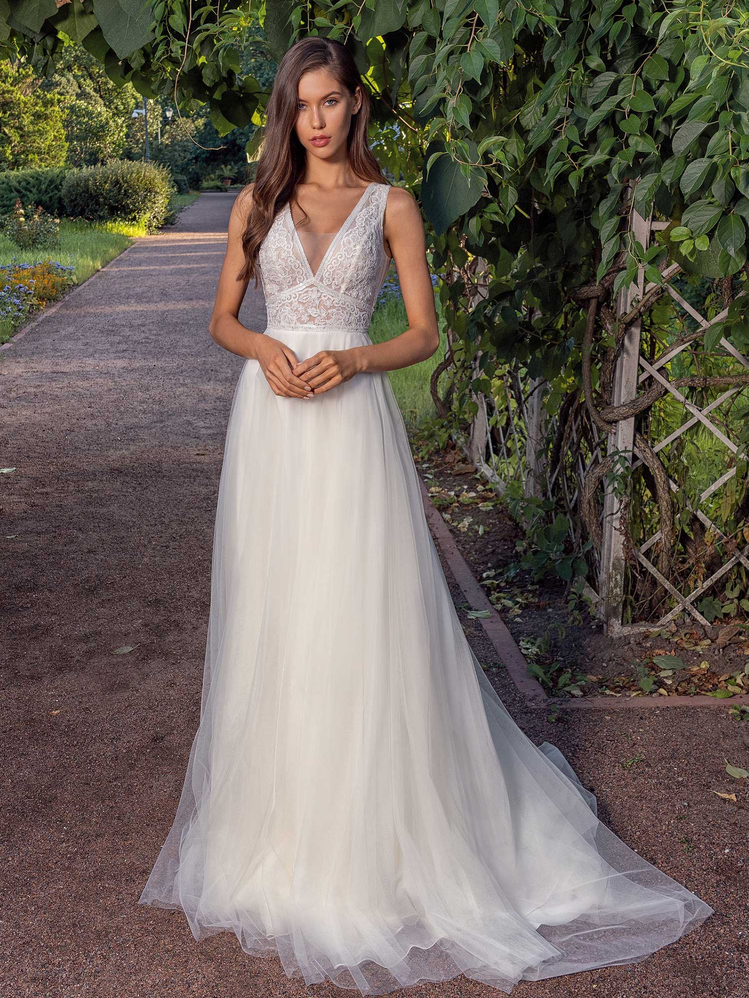 A line wedding dress with a deep V neckline lace bodice and illusion back